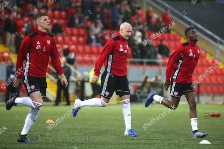 Derry City vs Dundalk. Derry's Eoin Toal, Grant Gillespie, and Junior Ogedi-Uzokwe during the pre match warm up
