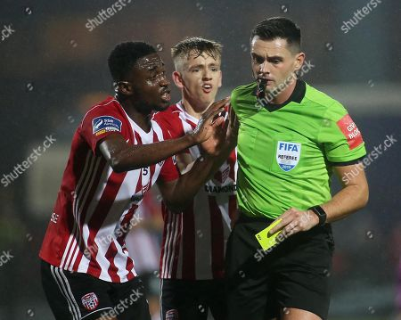 Derry City vs Dundalk. Derry's Junior Ogedi-Ozowke and Ciaron Harkin plead with match referee Robert Hennessy before he issues a second yellow card to Derry's Grant Gillespie