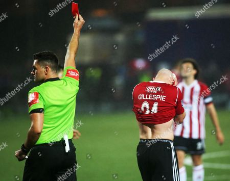 Stock Picture of Derry City vs Dundalk. Match referee Robert Hennessy sends off Derry's Grant Gillespie