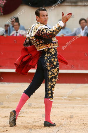 Spanish bullfighter Jose Maria Manzanares celebrates cutting one ear with his first bull during a bullfight held on the occasion of the 'Feria des vendanges' in Nimes, southern France, 14 September 2019. The fair runs from 13 to 15 September.