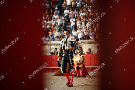 Stock Image of Spanish bullfighter Jose Maria Manzanares celebrates cutting one ear with his first bull during a bullfight held on the occasion of the 'Feria des vendanges' in Nimes, southern France, 14 September 2019. The fair runs from 13 to 15 September.