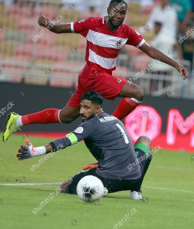 Al-Ahli player Yasser Al Mosailem (L) in action for the ball with Al-Wehda player ousef Nyakati (R) during the Saudi Professional League soccer match between Al-Ahli and Al-Wehda at King Abdullah international Stadium Aljawhara, Jeddah , Saudi Arabia, 14 September 2019.
