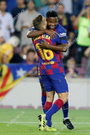 FC Barcelona's Ansu Fati (back) celebrates his goal with teammate Jordi Alba during  the Spanish LaLiga soccer match between FC Barcelona and Valencia at Camp Nou stadium in Barcelona, Spain, 14 September 2019.