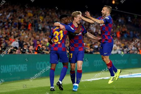 FC Barcelona's Frenkie de Jong (C) celebrates his goal with teammates Jordi Alba (R) and Ansu Fati (L) during the Spanish LaLiga soccer match between FC Barcelona and Valencia at Camp Nou stadium in Barcelona, Spain, 14 September 2019.