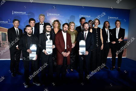 Robert Eggers, US-French director Carlo Mirabella Davis, US actor and director Michael Angelo Covino and US scriptwriter and actor Kyle Marvin pose around French actress and president of the Jury Catherine Deneuve and all the members of the Jury during a photocall of the winners during the 45th Deauville American Film Festival, in Deauville, France, 14 September 2019. The festival runs from 06 to 15 September 2019.
