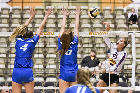 University of Northern Iowa middle hitter Emily Holterhaus (10) tips the ball over the blocking attempt of Boise State middle blocker Alyssa Wissinger (4) and Boise State setter Danielle Boss (6) during part of the Mizzou Invitational tournament where University of Northern Iowa Panthers played the Boise State Broncos held at Hearnes Center in Columbia, MO Richard Ulreich/CSM