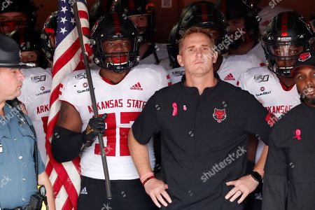 Arkansas State head coach Blake Anderson waits to lead his team onto the field for an NCAA college football game against Georgia, in Athens, Ga