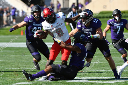 UNLV wide receiver Tyleek Collins (9) runs against Northwestern linebacker Paddy Fisher (42), linebacker Blake Gallagher (51) and defensive back JR Pace, front, during the first half of an NCAA college football game, in Evanston, Ill