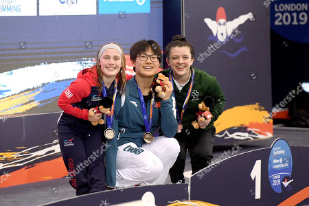 Women's 50m butterfly . Ireland's Nicole Turner celebrates after finishing third with Jiang Yuyan and Ellie Robinson