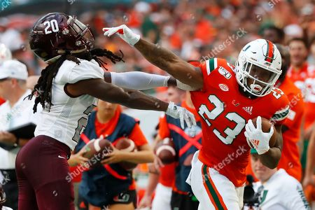Cam'Ron Harris, Trevor Merritt. Bethune-Cookman cornerback Trevor Merritt (20) attempts to stop Miami running back Cam'Ron Harris (23) during the first half of an NCAA college football game, in Miami Gardens, Fla