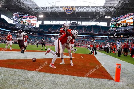 Larry Hodges, Cam'Ron Harris. Miami tight end Larry Hodges, foreground, celebrates with running back Cam'Ron Harris after scoring during the second half of an NCAA college football game against Bethune-Cookman, in Miami Gardens, Fla