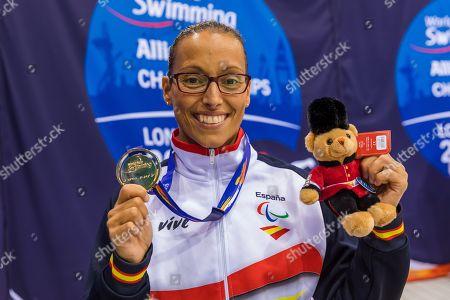 Teresa Perales of Spain poses for photographs with her gold medal after winning the Women's 50m Backstroke S5 final during day six of the World Para Swimming Championships at the London Aquatics Centre in London, Britain, 14 September 2019. The event is one of the largest Para Swimming championships and will see nearly 600 swimmers compete from 09 September to 15 September 2019.