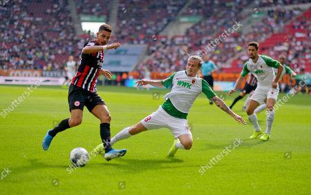 14.09.2019, Football 1. Bundesliga 2019/2020, 4. match day, FC Augsburg - Eintracht Frankfurt, in WWK-Arena Augsburg. v.li: Andre Silva (Eintracht Frankfurt)  -  Tin Jedvaj (FC Augsburg)