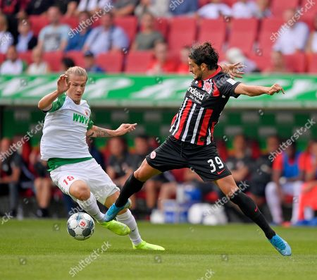 14.09.2019, Football 1. Bundesliga 2019/2020, 4. match day, FC Augsburg - Eintracht Frankfurt, in WWK-Arena Augsburg. v.li: Tin Jedvaj (FC Augsburg)  -  Goncala Paciencia (Eintracht Frankfurt).