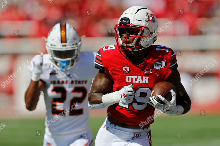 Bryan Thompson, Caleb Brown. Utah wide receiver Bryan Thompson (19) catches a touchdown pass against Idaho State defensive back Caleb Brown (22) in the first half of an NCAA college football game, in Salt Lake City