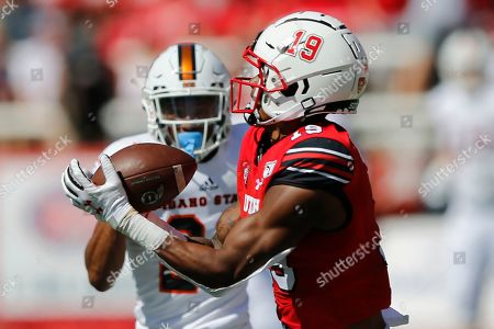 Bryan Thompson, Caleb Brown. Utah wide receiver Bryan Thompson (19) catches a touchdown pass as Idaho State defensive back Caleb Brown (22) defends in the first half of an NCAA college football game, in Salt Lake City