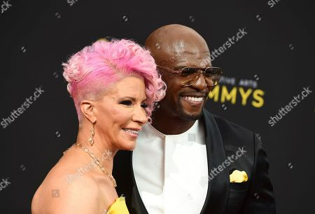Rebecca Crews, Terry Crews. Rebecca Crews, left, and Terry Crews arrive at night one of the Television Academy's 2019 Creative Arts Emmy Awards, at the Microsoft Theater in Los Angeles