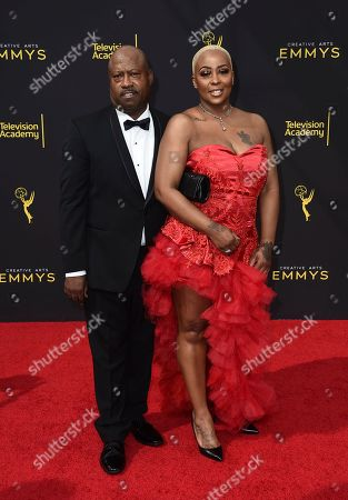 Stock Picture of Michelle Kramer, Dwayne Carter. Michelle Kramer, right, and Dwayne Carter arrive at night one of the Television Academy's 2019 Creative Arts Emmy Awards, at the Microsoft Theater in Los Angeles