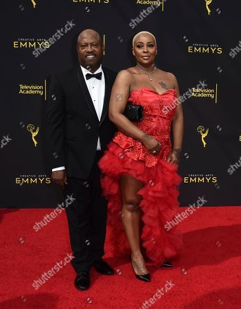 Stock Photo of Michelle Kramer, Dwayne Carter. Michelle Kramer, right, and Dwayne Carter arrive at night one of the Television Academy's 2019 Creative Arts Emmy Awards, at the Microsoft Theater in Los Angeles