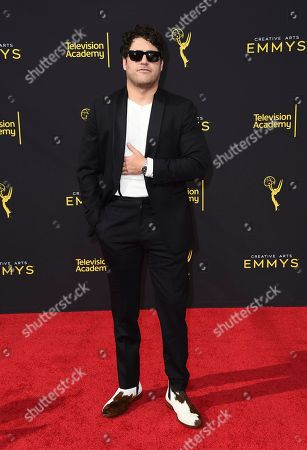 Adam Pally arrives at night one of the Television Academy's 2019 Creative Arts Emmy Awards, at the Microsoft Theater in Los Angeles