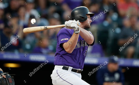 R m. Colorado Rockies' Daniel Murphy watches his RBI single off San Diego Padres starting pitcher Eric Lauer during the second inning of a baseball game, in Denver