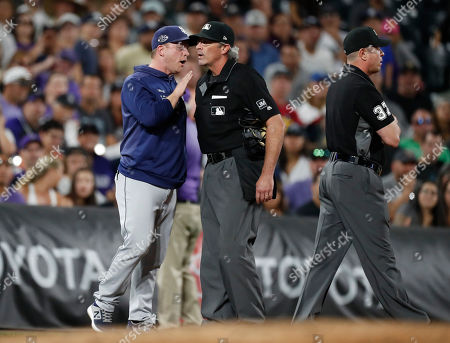 R m. From left, San Diego Padres manager Andy Green argues with umpire Paul Nauert after Green was ejected by third base umpire Carlos Torres during the fifth inning of the team's baseball game against the Colorado Rockies, in Denver
