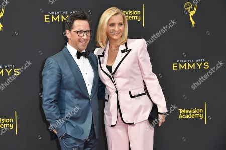 Dan Bucatinsky, left, and Lisa Kudrow arrive at night one of the Creative Arts Emmy Awards, at the Microsoft Theater in Los Angeles