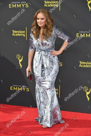 Leah Remini arrives at night one of the Creative Arts Emmy Awards, at the Microsoft Theater in Los Angeles