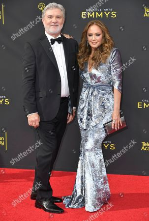 Mike Rinder, Leah Remini. Mike Rinder, left, and Leah Remini arrive at night one of the Creative Arts Emmy Awards, at the Microsoft Theater in Los Angeles