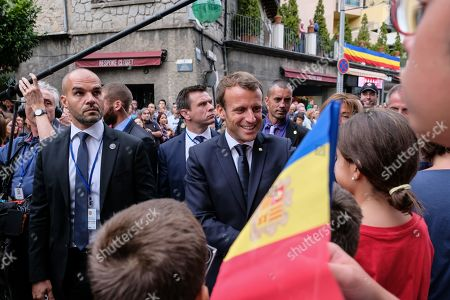 French President and Andorra co-Prince Emmanuel Macron signs autographs and is greeted by supporters as he arrives in Canillo