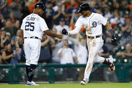 Detroit Tigers' Victor Reyes, right, celebrates with Dave Clark (25) after hitting a tying solo home run against Baltimore Orioles' Mychal Givens during the ninth inning of a baseball game, in Detroit