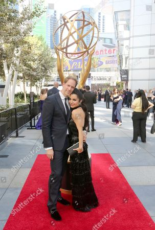 David Korins, Martha Higareda. David Korins, left, and Martha Higareda arrive at night one of the Television Academy's 2019 Creative Arts Emmy Awards, at the Microsoft Theater in Los Angeles