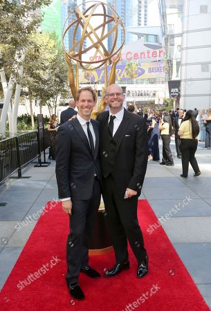 Stock Image of David Korins, Adam Rowe. David Korins, left, and Adam Rowe arrive at night one of the Television Academy's 2019 Creative Arts Emmy Awards, at the Microsoft Theater in Los Angeles