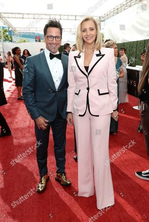 Dan Bucatinsky, Lisa Kudrow. Dan Bucatinsky, left, and Lisa Kudrow arrive at night one of the Television Academy's 2019 Creative Arts Emmy Awards, at the Microsoft Theater in Los Angeles