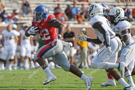 Mississippi running back Scottie Phillips (22) runs the ball during the first half of an NCAA college football game against Southeastern Louisiana in Oxford, Miss