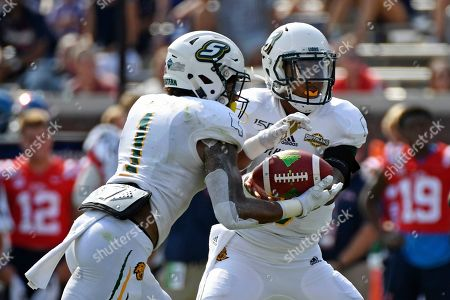 Chason Virgil, Devonte Williams. Southeastern Louisiana quarterback Chason Virgil (9) hands the ball off to running back Devonte Williams (1) during the first half of an NCAA college football game against Mississippi in Oxford, Miss