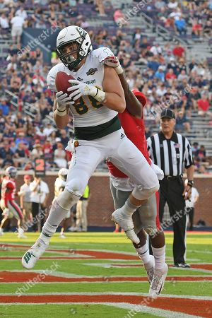 Stock Photo of Austin Mitchell, Brandon Mack. Southeastern Louisiana wide receiver Austin Mitchell (81) catches a touchdown pass over Mississippi linebacker Brandon Mack (4) during the second half of an NCAA college football game in Oxford, Miss., . Mississippi won 40-29