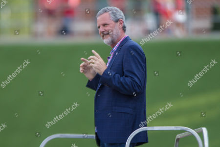Liberty Flames President Jerry Falwell Jr. leads Liberty University band in the schools fight song before NCAA football action between the Buffalo Bulls and the Liberty Flames at Williams Stadium in Lynchburg, VA