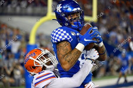 Kentucky tight end Keaton Upshaw (88) makes a catch over the defense of Florida defensive back Brad Stewart Jr. for a touchdown during the second half of an NCAA college football game in Lexington, Ky., . Florida won 29-21