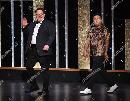 Jon Farvreau, Roy Choi. Jon Farvreau, left, and Roy Choi walk on stage on night one of the Television Academy's 2019 Creative Arts Emmy Awards, at the Microsoft Theater in Los Angeles