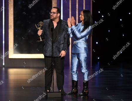 "Art Conn, Zaldy Goco. Art Conn, left, and Zaldy Goco from ""Rupaul's Drag Race"" accept the award for outstanding costumes for variety, nonfiction or reality programming for ""Trump The Musical"" on night one of the Television Academy's 2019 Creative Arts Emmy Awards, at the Microsoft Theater in Los Angeles"