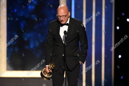 """Dan Reed accepts the award for outstanding documentary or nonfiction special for """"Leaving Neverland"""" on night one of the Television Academy's 2019 Creative Arts Emmy Awards, at the Microsoft Theater in Los Angeles"""