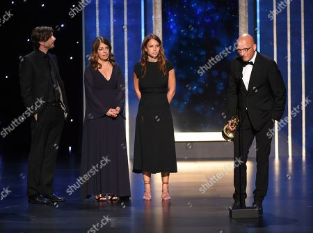 """Nancy Abraham, Lisa Heller, Dan Reed. Director and Producer Dan Reed and the crew of """"Leaving Neverland"""" accept the award for outstanding documentary or nonfiction special on night one of the Television Academy's 2019 Creative Arts Emmy Awards, at the Microsoft Theater in Los Angeles"""
