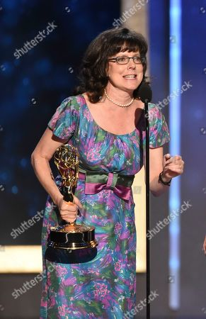 """Julie Cohen accepts the award for exceptional merit in documentary filmmaking for """"RBG"""" on night one of the Television Academy's 2019 Creative Arts Emmy Awards, at the Microsoft Theater in Los Angeles"""