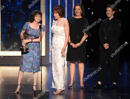 """Julie Cohen, Betsy West, Amy Entelis, Courtney Sexton. Julie Cohen, from left, Betsy West, Amy Entelis, and Courtney Sexton accept the award for exceptional merit in documentary filmmaking for """"RBG"""" on night one of the Television Academy's 2019 Creative Arts Emmy Awards, at the Microsoft Theater in Los Angeles"""