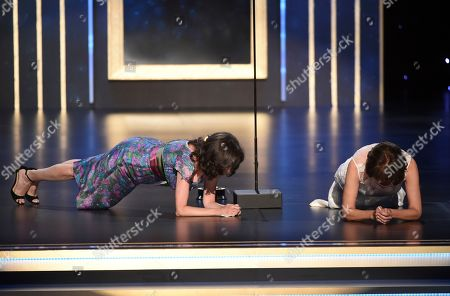 Julie Cohen, Betsy West. Julie Cohen, left, and Betsy West do the plank like RBG on stage on night one of the Television Academy's 2019 Creative Arts Emmy Awards, at the Microsoft Theater in Los Angeles