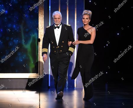 Captain Lee Rosbach, Kate Chastain. Captain Lee Rosbach, left, and Kate Chastain walk on stage on night one of the Television Academy's 2019 Creative Arts Emmy Awards, at the Microsoft Theater in Los Angeles