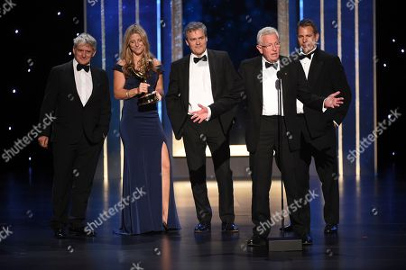 "Sophie Lanfear, Keith Scholey. Series Producer Keith Scholey, second right, and the crew of ""Our Planet"" accept the award for outstanding documentary or nonfiction series on night one of the Television Academy's 2019 Creative Arts Emmy Awards, at the Microsoft Theater in Los Angeles"
