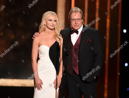 Mandy Hansen, Sig Hansen. Mandy Hansen, left, and Sig Hansen speak on stage on night one of the Television Academy's 2019 Creative Arts Emmy Awards, at the Microsoft Theater in Los Angeles