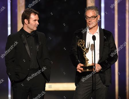 """Brandon Roberts, Marco Beltrami. Brandon Roberts, left, and Marco Beltrami accept the award for outstanding music composition for a documentary series or special for """"Free Solo"""" on night one of the Television Academy's 2019 Creative Arts Emmy Awards, at the Microsoft Theater in Los Angeles"""